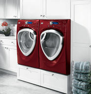 A raised, front-loading washer and dryer set makes doing laundry easier for those in wheelchairs.