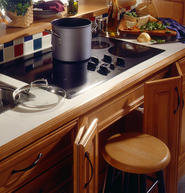 Swiveling cabinet doors under the cooktop fold out of the way, providing valuable knee space.