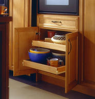 Roll-out shelves make it easier to see and reach items stored in lower cabinets.