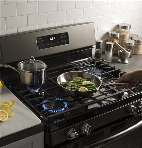 Two-piece continuous edge-to-edge cooktop